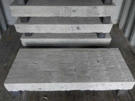 Large fabricated concrete blocks, smooth slabs containing rebar or cut out blocks with rebar